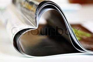 Magazine folded to heart shape on table