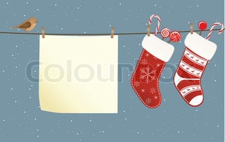 Christmas socks full of candies hanged on a clothesline next to a piece of paper