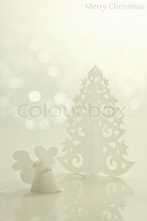 Handmade angel and Christmas tree cut out from office paper