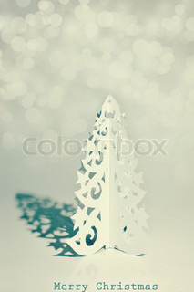 Handmade Christmas tree cut out from paper Retro stylized