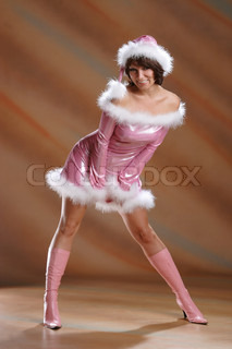 Snow Maiden in a pink dress on photography
