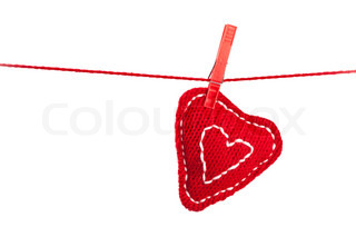 single knitted heart on a red string isolated on white background