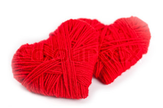 two red thread hearts isolated on white background