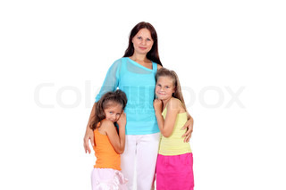 Mother standing with her two daughters in studio