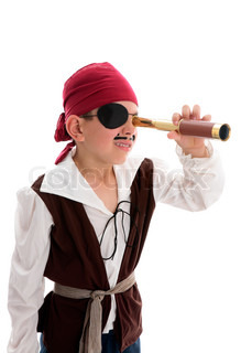 A young boy pirate looking through a monoscope in search of treasure or ships to plunder