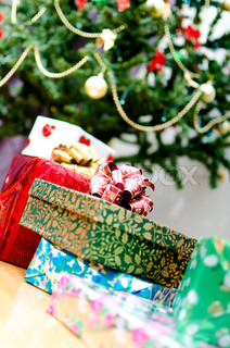 few gifts at Christmas tree