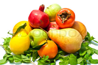 a lot of different fruits and green leaves on white background