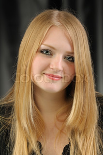 Portrait of the pretty young girl of the blonde