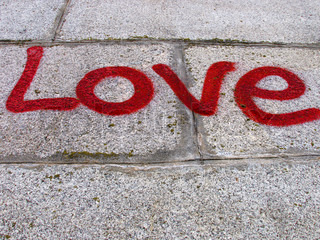 word Love on a pavement