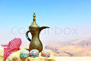 Arabian souvenirs on the stone and Jordan's mountains in the background