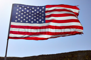 Flag of USA on the wind close-up