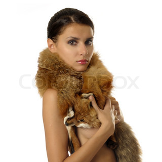 Portrait of the beautiful naked girl with furs