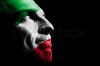 On the painted colors of the flag of his country on his face