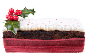 Traditional christmas top iced fruit cake isolated on white background