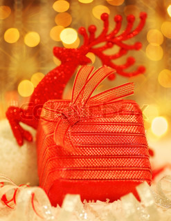 Winter holiday background with golden present gift box christmas christmas holiday background card with red present gift box christmas tree deer ornament defocus negle Image collections