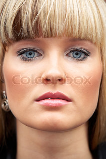 Close-up of face of young woman, full frame