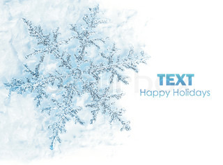 Beautiful blue snowflake isolated, winter holiday background with copy space