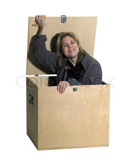 girl sitting in a wooden box