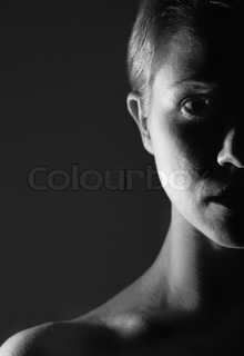 half of theface of girl in the dark, monochrome