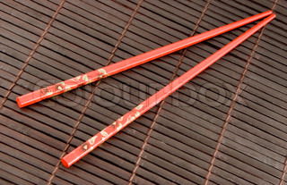A pair of traditional chinese chopsticks on bamboo