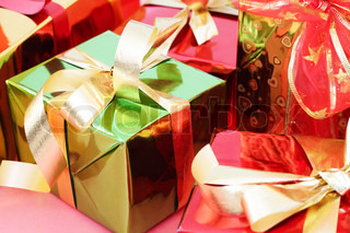 Several multi-colored gift boxes