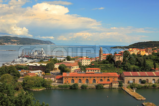Panoramic aerial view on naval base and Mediterranean sea in city of La Spezia in Italy.
