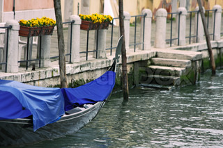 City canal with gondolas in Venice, Italy