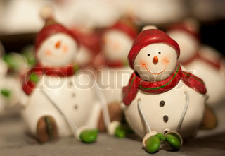 Small snowman puppet with scarf and gloves
