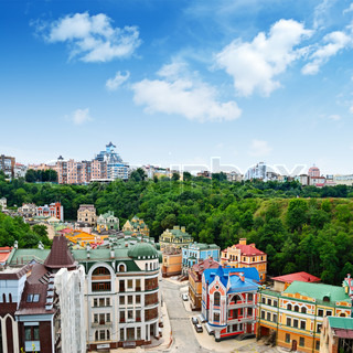 Multicolored houses among the green trees and blue sky Panoramic view from the hill Placed in Kiev, Ukraine almost in center of city