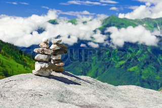 Stone towers Two pyramid of meditation zen stones on mountains landscape