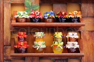 Colorful jam jars arranged for sale