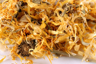 heap of dried marigold for herbal tea