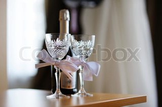 Two empty wedding champagne glasses with a bows