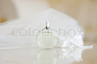 Wedding veil, perfume bottle and a garter