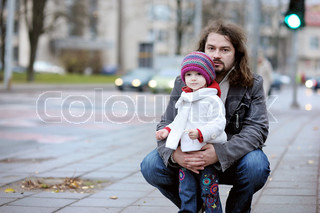 Young father and his toddler girl at late autumn