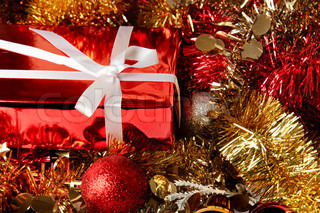 Christmas decoration with red gift box and shiny tinsel