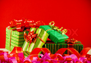 Wrapped boxes with presents against red background