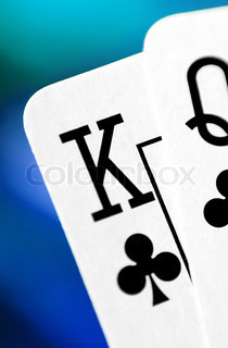 playing cards on a colorful soft green background
