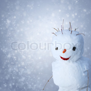 Funny Snowman with carot and sticks under snowy background