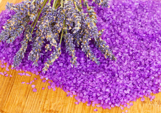 dry lavender with bath salt on wooden table
