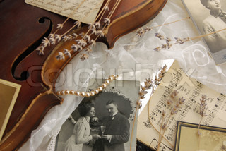 Vintage composition with old photos and violin