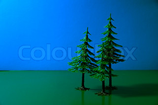 Trees on a dark blue and green background