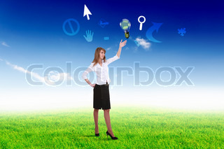 Businesswoman standing on green grass and thinking creatively