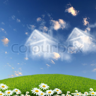 Picture of a house from white clouds against blue sky