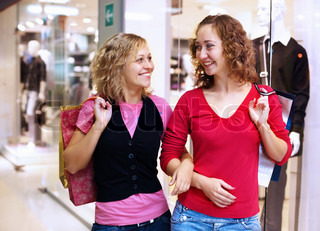 Young woman doing shopping and choosing clothes