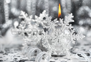 Christmas decoration, silver holiday background with candle & snowflake