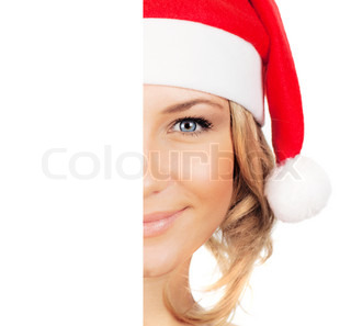 Santa girl closeup portrait, half face of a young woman smiling, wearing Christmas hat, winter holidays fun, isolated over white background with copy space