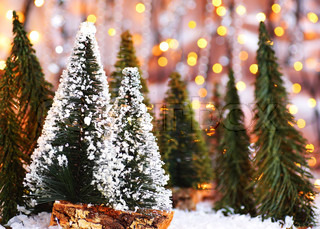 Christmas tree forest, holiday background with winter ornament & abstract defocus lights decoration