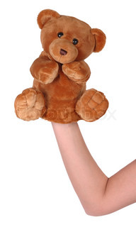 Hand puppet of bear isolated on white