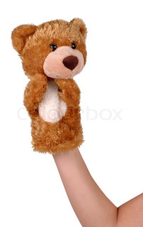 Hand puppet of brown bear isolated on white